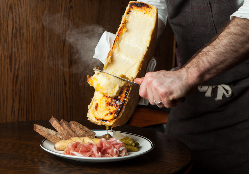 A picture of raclette being served.